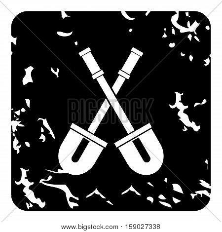Two crossed shovels icon. Grunge illustration of two crossed shovels vector icon for web