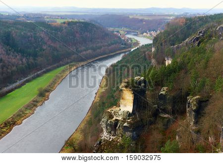 View of the Elbe river and the Wartturm rocks major landmark of the Saxon Switzerland National Park. Germany