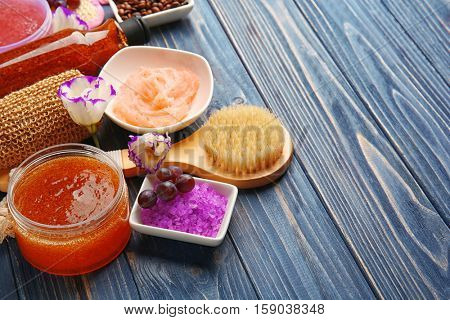Body care set for peeling on wooden background, closeup