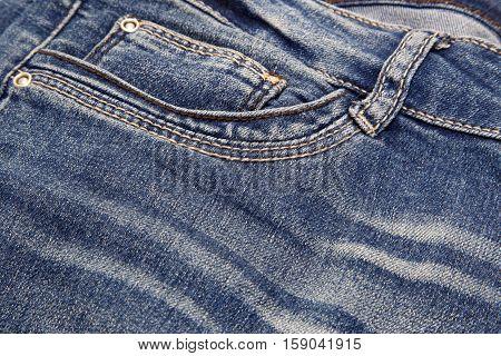 Fragment of dark blue jeans close-up background