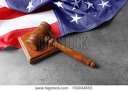 Judge gavel and American flag on table