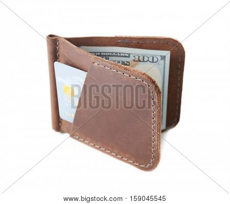 Opened brown leather wallet with money and credit card isolated on white