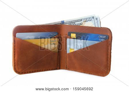Opened brown leather wallet with credit cards isolated on white