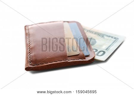 Brown leather wallet with credit cards and money isolated on white
