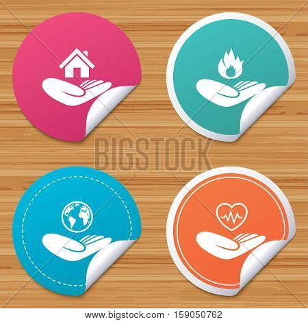 Round stickers or website banners. Helping hands icons. Health and travel trip insurance symbols. Home house or real estate sign. Fire protection. Circle badges with bended corner. Vector