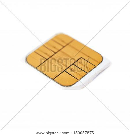 Used scratched credit card chip macro isolated over white background