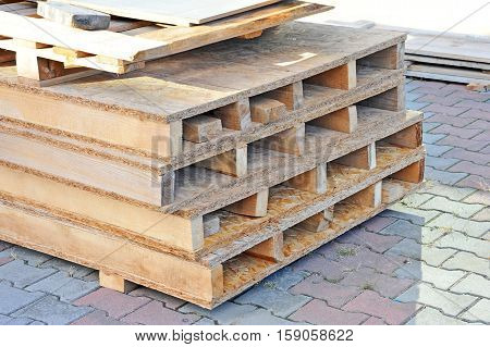 Wooden board for terrace stacked at construction site