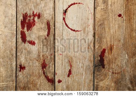 Red wine stains on wooden background