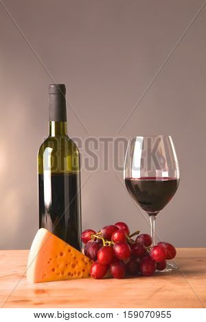 wine bottle and wine glass on a glass table.