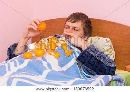 A Man Who Lies In Bed Sick Of Mandarins