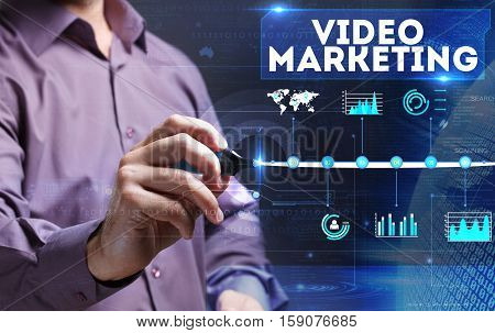 Technology, Internet, Business And Marketing. Young Business Man Writing Word: Video Marketing
