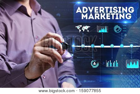 Technology, Internet, Business And Marketing. Young Business Man Writing Word: Advertising Marketing