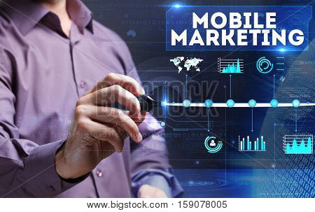 Technology, Internet, Business And Marketing. Young Business Man Writing Word: Mobile Marketing