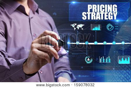 Technology, Internet, Business And Marketing. Young Business Man Writing Word: Pricing Strategy
