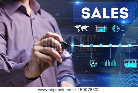 Technology, Internet, Business And Marketing. Young Business Man Writing Word: Sales