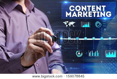 Technology, Internet, Business And Marketing. Young Business Man Writing Word: Content Marketing