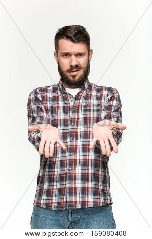 Man wearing a checkered shirt is looking pouter with an imaginary object in his hands. Over white background