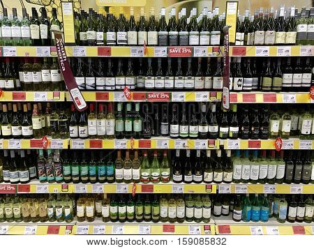 LONDON - NOVEMBER 29: Wine bottles in the alcohol aisle of Sainsbury's Supermarket at the O2 Centre Finchley Road on November 29, 2016 in London, UK.