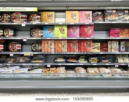 LONDON - NOVEMBER 29: Pizzas in a refrigerated aisle at Waitrose John Barnes Finchley Road on November 29, 2016 in London, UK.