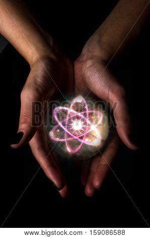 Holding atom in fortune teller magic crystal ball