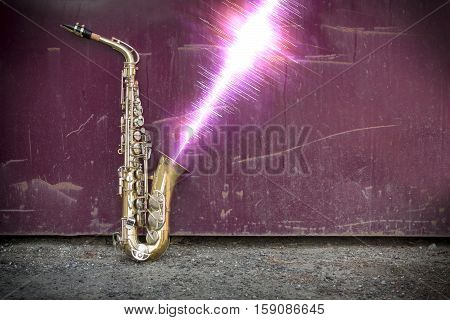 Jazz saxophone with sound wave on grungy street