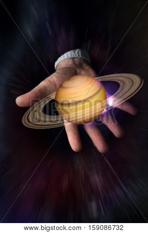 Hand holding 3D illustration of the planet saturn with stars