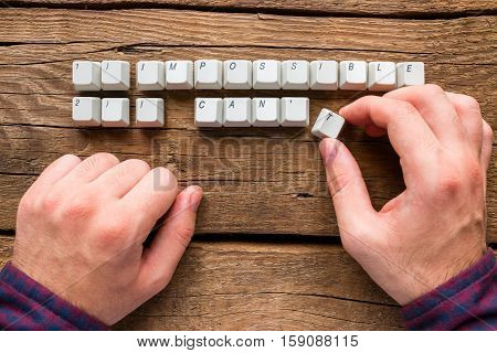 Man Changes The Words Impossible And I Can't To Possible And I Can Of Keyboards Keys