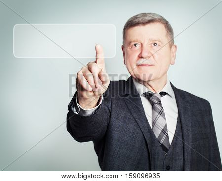 Confident Mature Businessman Surfing through the Internet with Virtual Web Browser. Senior Man on Black Background
