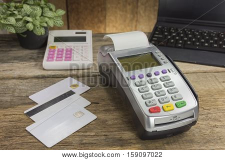 Credit Card Terminal Or Edc On Cashier Wooden Table In The Store With Calculator, Clock,credit Cards