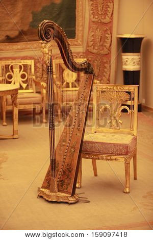 classical harp in a luxurious living room