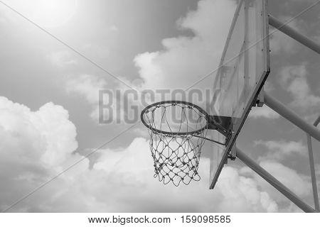 Basketball Hoop On A Blue Sky , Black And White