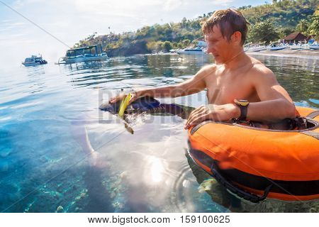 Free divers training in low water in the sea near the coast, Amed, Indonesia