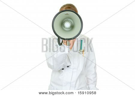 Medical doctor woman standing in front of camera and speaking into megaphone isolated on white