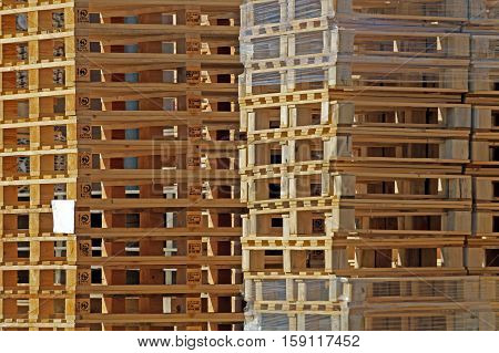 Big stack of wooden pallets for logistic trasnsport