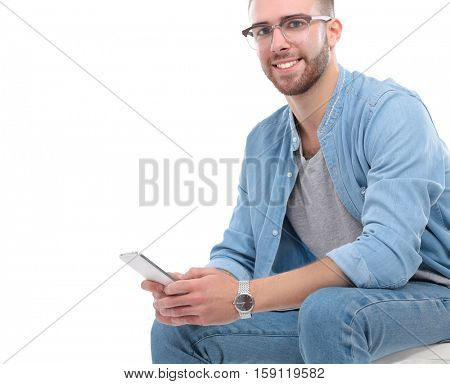 A young guy with a mobile phone, isolated on white background