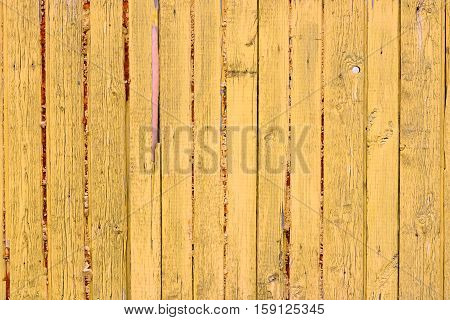 old wooden fence with yellow paint decor background wallpaper