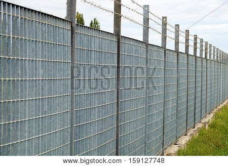 Steel anti entry fence with sharp spikes.