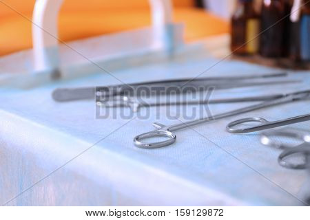 Gynecological tools on doctor's table in clinic
