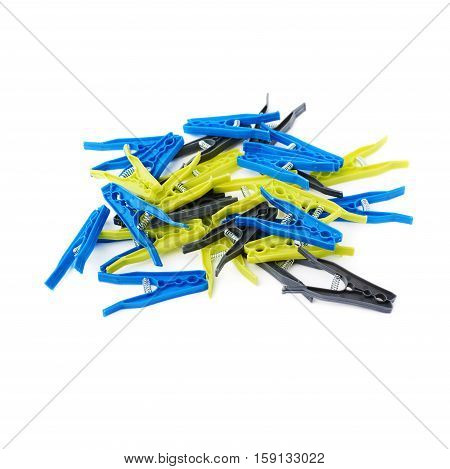 Pile of plastic cloth pegs isolated over white background