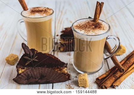 Chocolate Cake, Two Cups Of Cappuccino And Spices