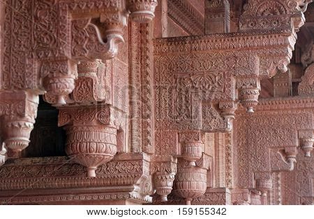AGRA, INDIA - FEBRUARY 14 : Columns with stone carving in Agra Fort, UNESCO World heritage site in Agra. Uttar Pradesh, India on February 14, 2016.