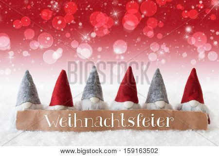 Label With German Text Weihnachtsfeier Means Christmas Party. Christmas Greeting Card With Gnomes. Sparkling Bokeh And Red Background With Snow, Snowflakes And Stars.