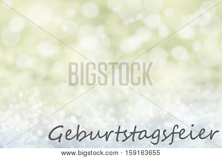 German Text Geburtstagsfeier Means Birthday Party. Golden Bokeh Christmas Background Or Texture With Snow. Copy Space For Your Text Here