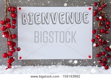 Label With French Text Bienvenue Means Welcome. Red Christmas Decoration On Snow. Urban And Modern Cement Wall As Background With Snowflakes.