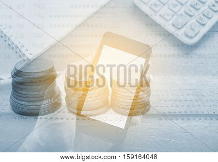 Double exposure stack of coins with hand holding smart phone mobile and account banking for finance online concept, Finance and money online concept