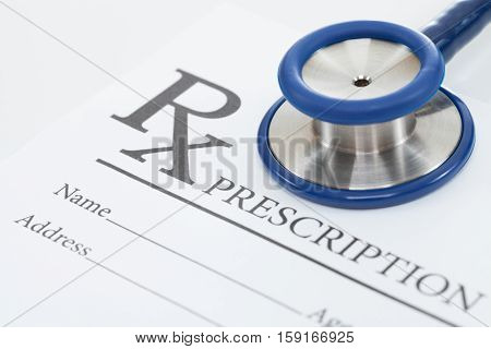 Medical Prescription Form And Stethoscope On Table