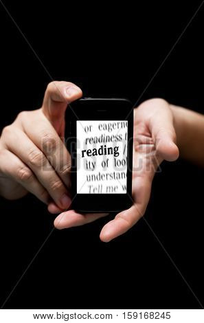 Hands Holding Smartphone, Showing  The Word  Reading Printed