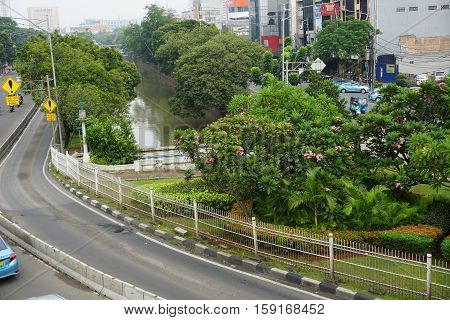 city park in middle of street java jakarta indonesia