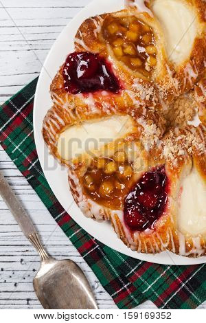 Danish Pastry Ring with Cherry, Apple fruit and Cheese fillings. Selective focus.
