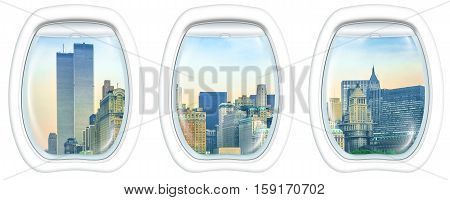 Three plane windows on New York City with World Trade Center and Twin Towers, Manhattan, United States, from a plane on the porthole windows. Copy space.